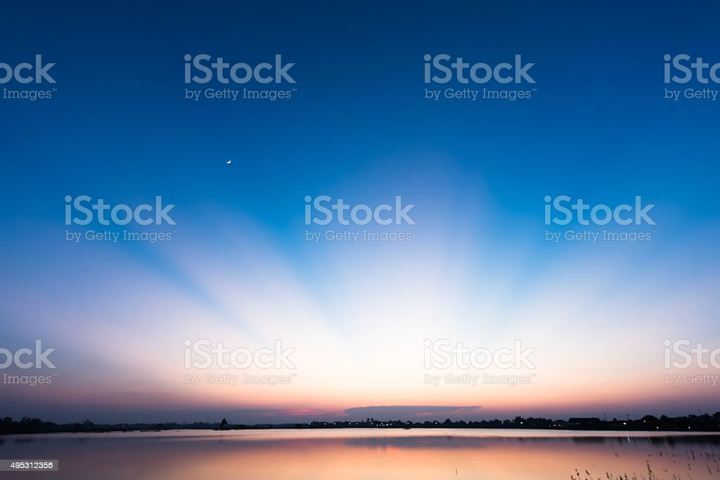 Wonderful light after sunset over the lake stock photo
