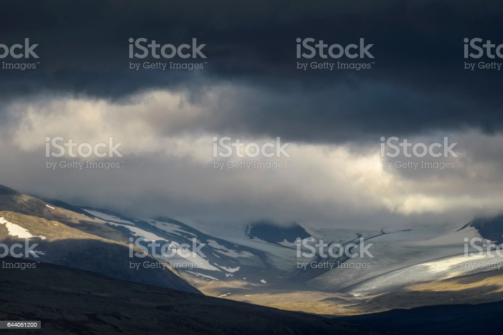 Wonderful sunlight on stone and ice carved pattern in Sarek glacier valley stock photo