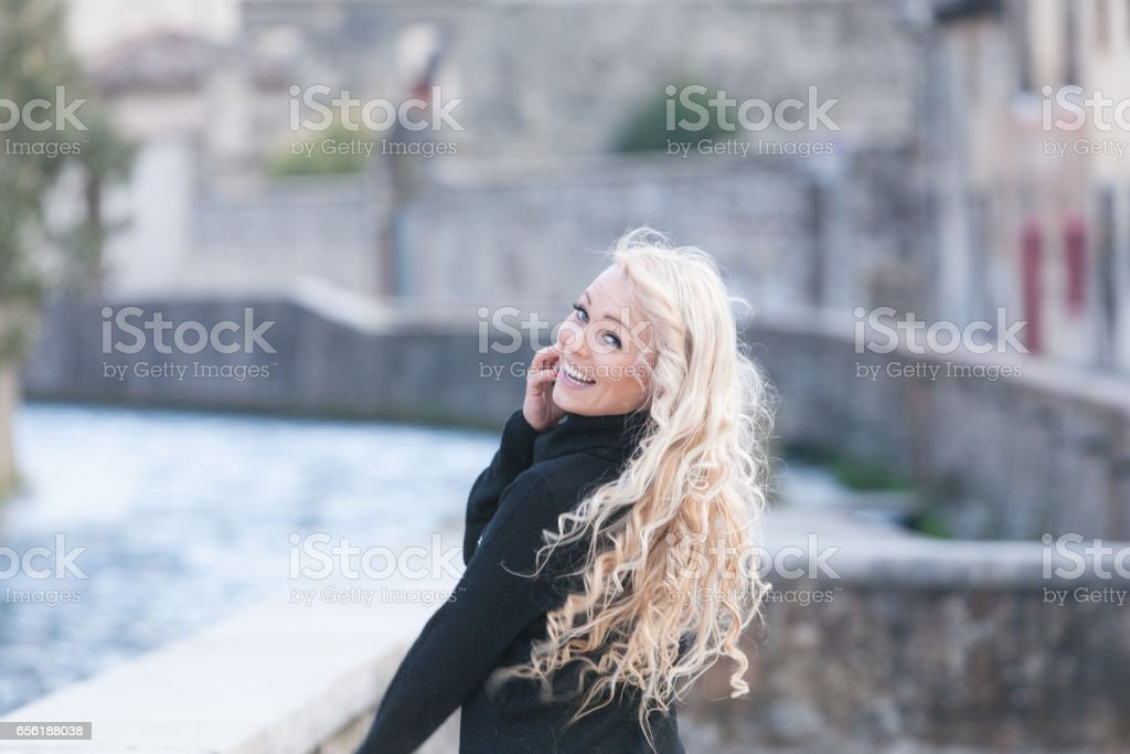 wonderful woman is a tourist in Europe stock photo