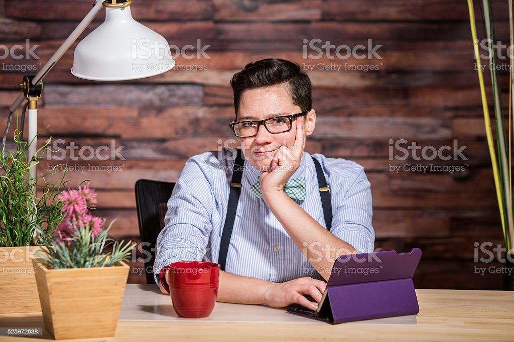 Wondering Female in Suspenders at Desk stock photo