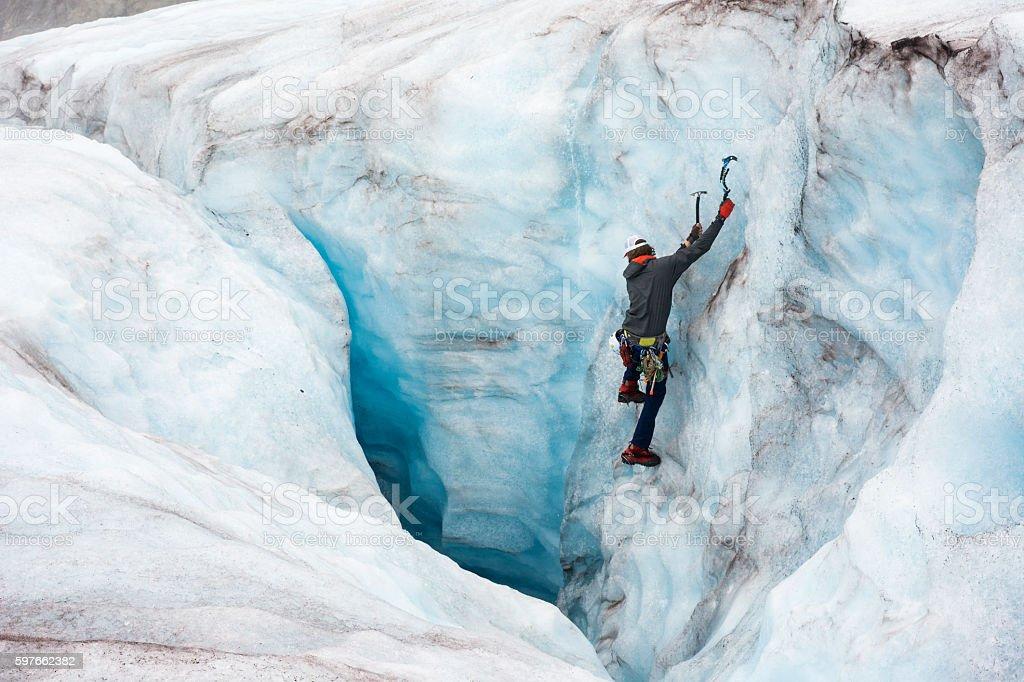 Wonderlust ice climbing in crevasse stock photo