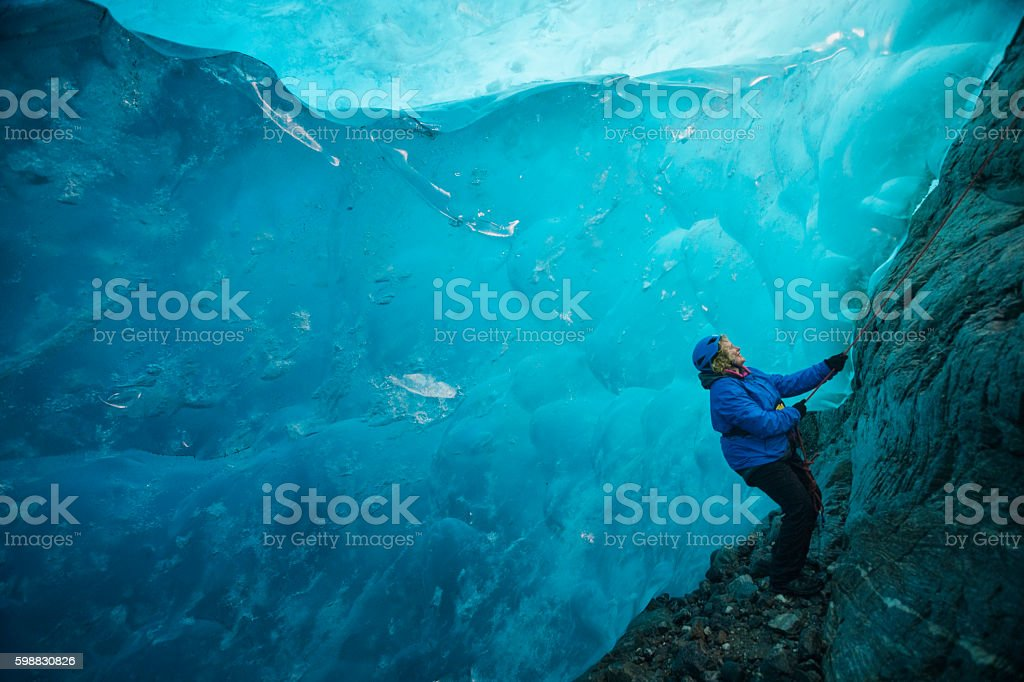 wonderlust in a blue ice cave stock photo