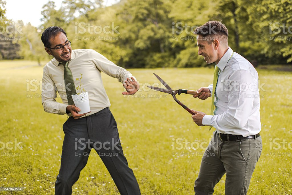 I won't let you to cut my plant! stock photo