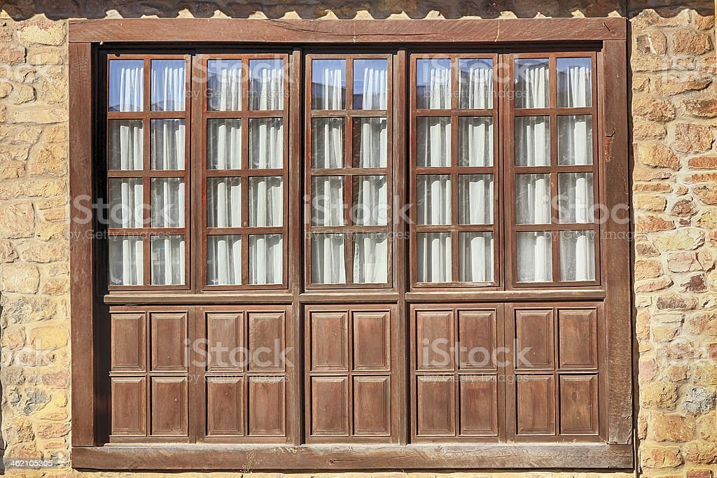 Wood and glass windows in Santillana del Mar Spain stock photo