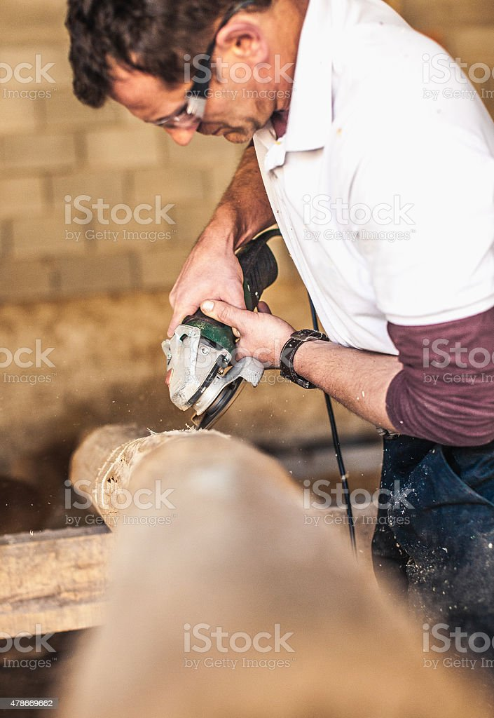 Wood artist creating sculpture from hardwood stock photo