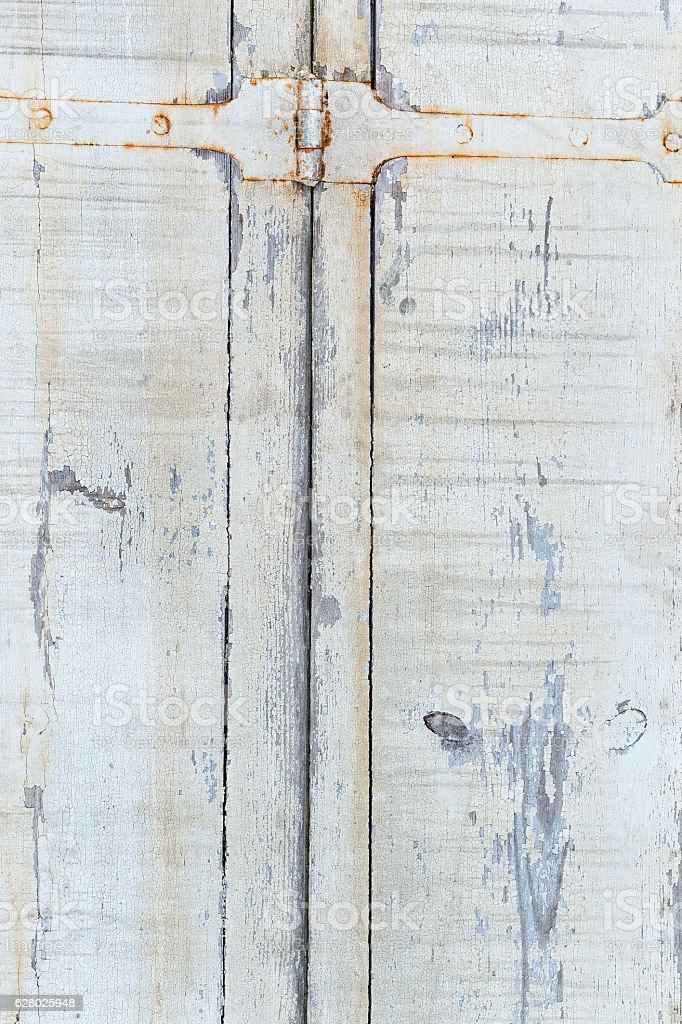 Wood backgrounds Old door from darkened boards with archaic iron stock photo