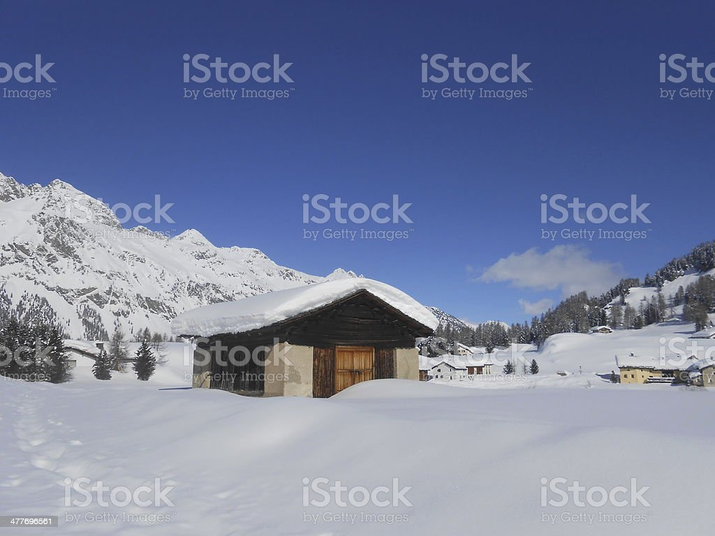 wood barn in Val Fex stock photo