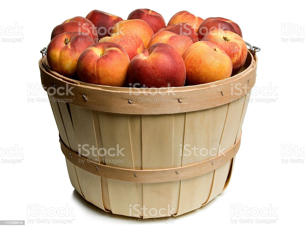 Wood basket with peaches royalty-free stock photo