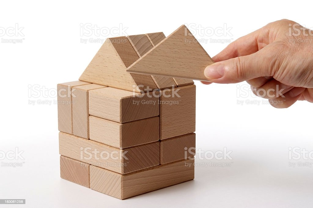 Wood block house made by hand on white background. stock photo