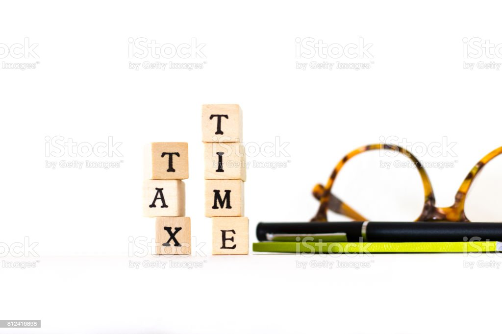 Wood Block Letters Spelling TAX TIME, Glasses, Pen, Notebook stock photo