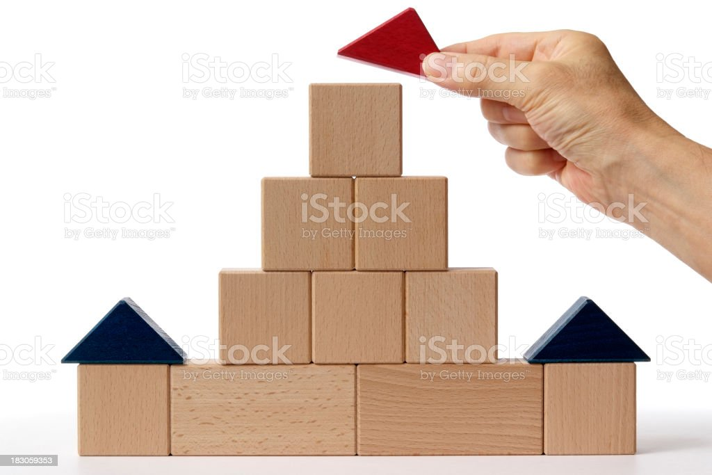 Wood blocks house made by hand on white background. royalty-free stock photo