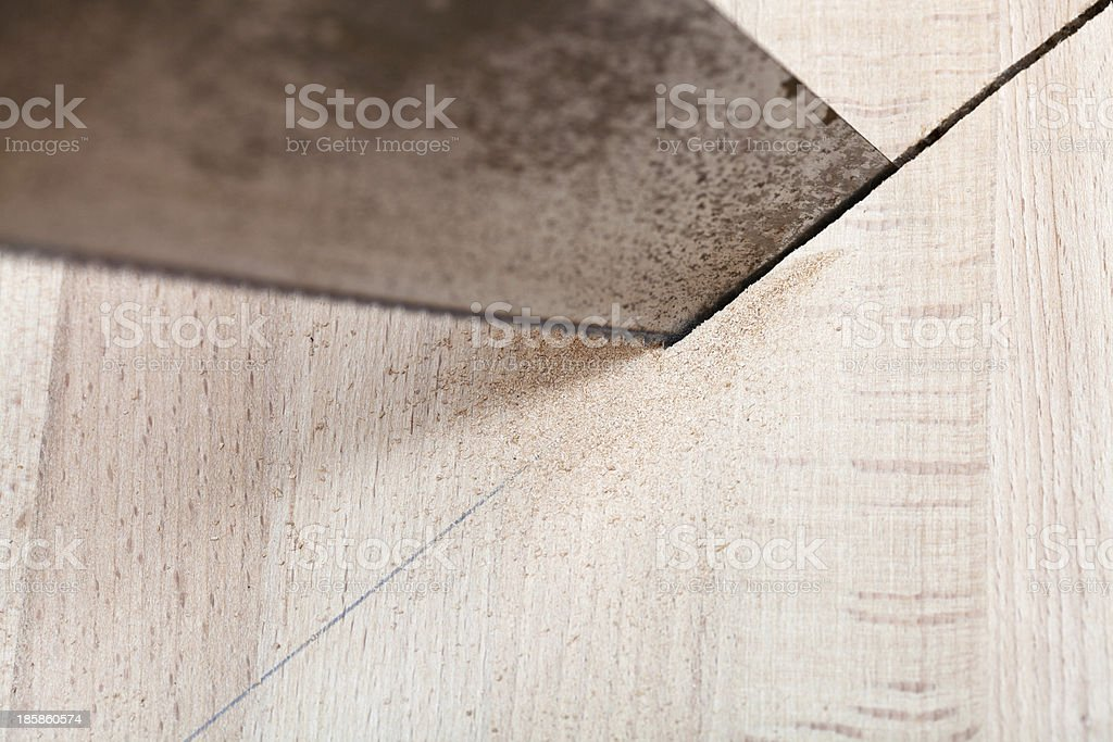 wood board is cut with hacksaw stock photo