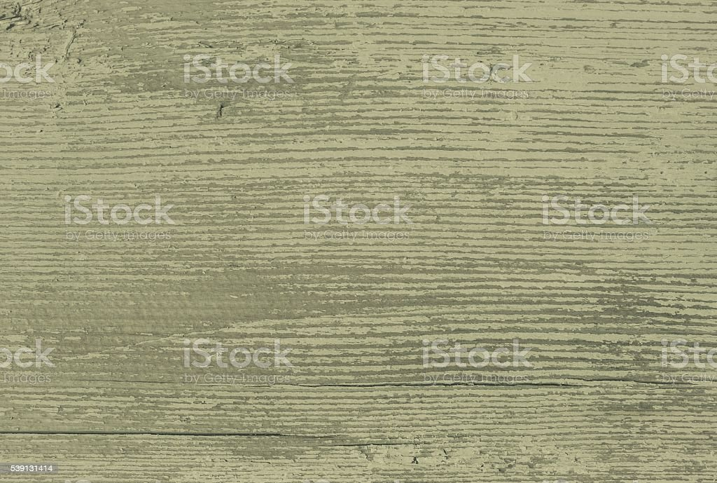 wood board painted with an olive hue stock photo