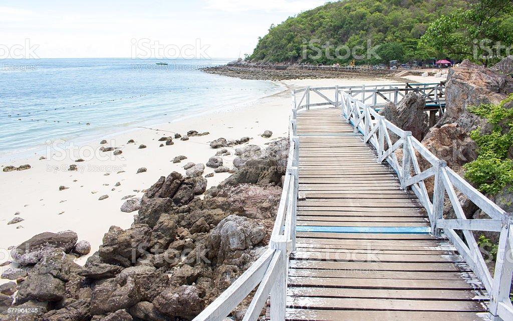 Wood bridge and blue sea and bright landscape stock photo