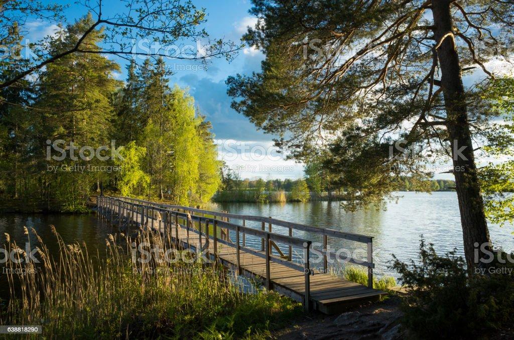 Wood Bridge At Lake In Autumn stock photo