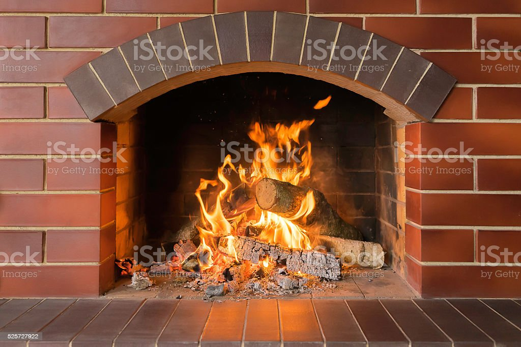 Wood burning fireplace in a bright fire stock photo