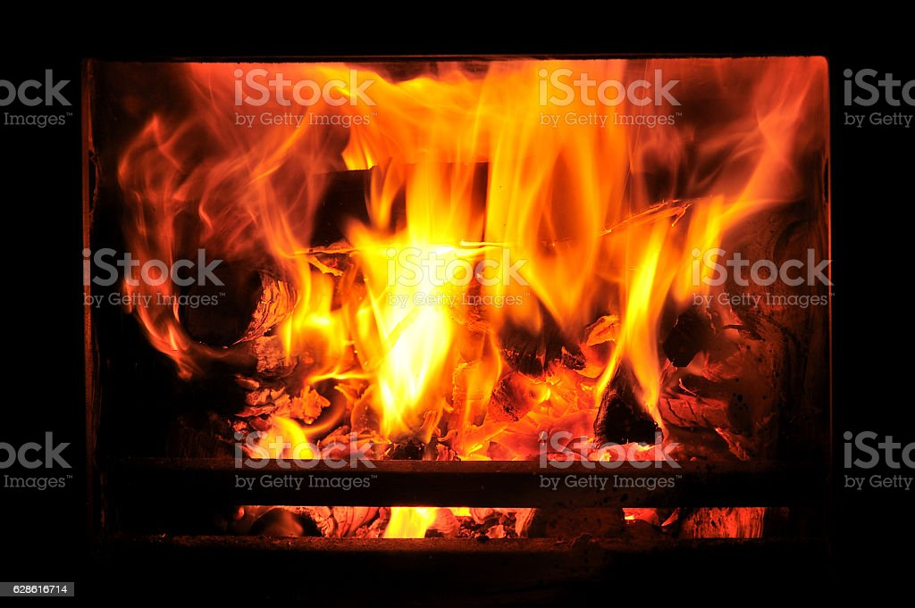 Wood burning stove with fire stock photo