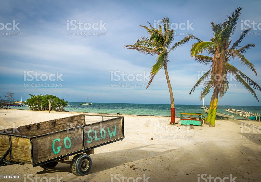 Wood Cart with Go Slow message stock photo