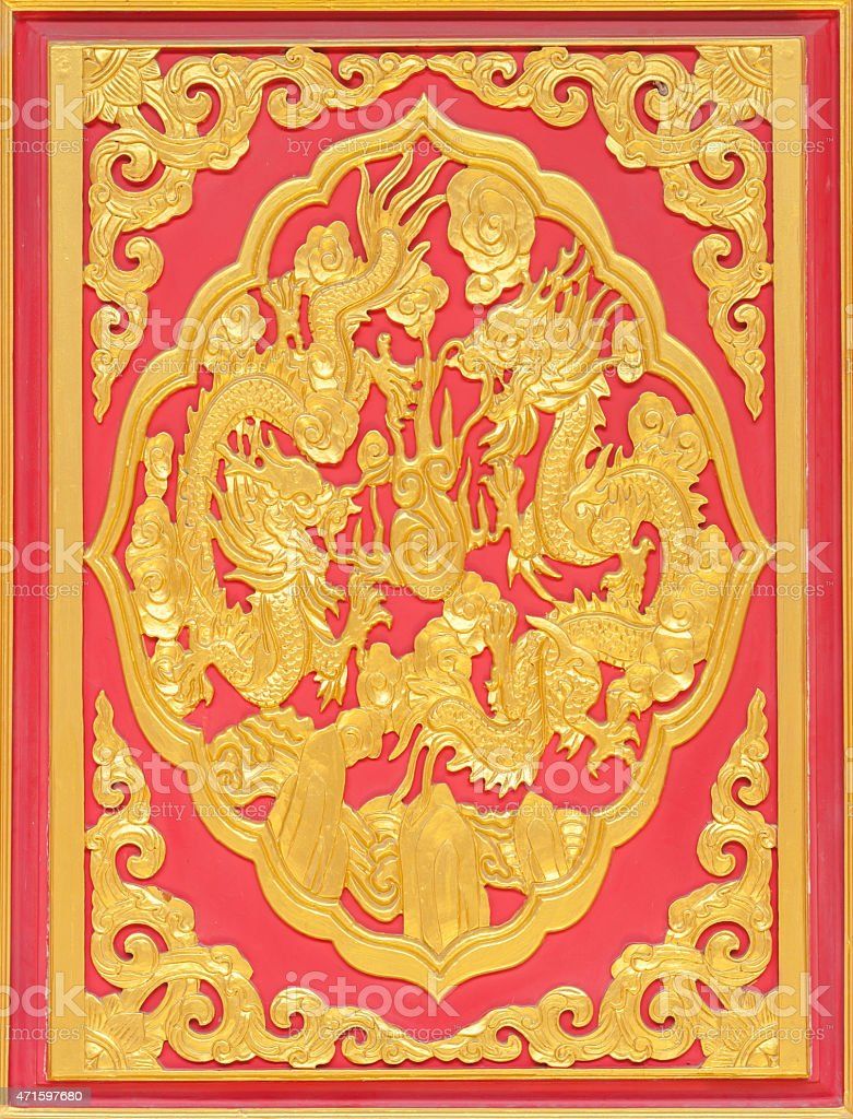Wood carved in red background stock photo