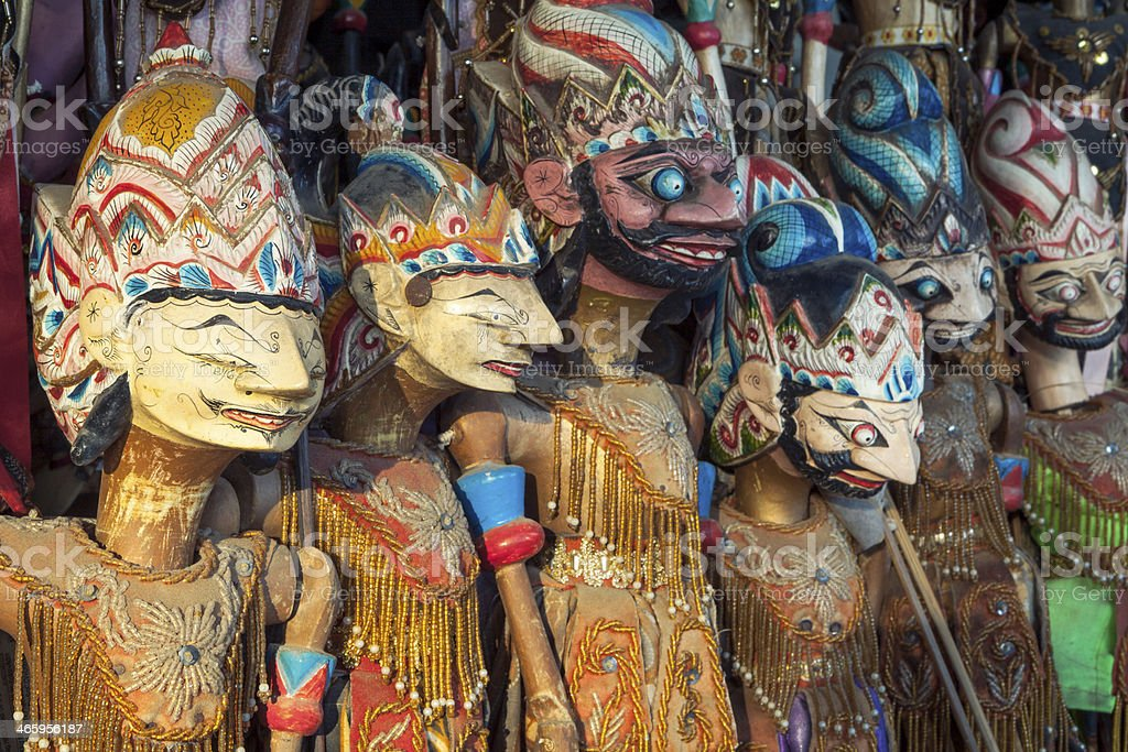 Wood carved shadow puppets, Yogyakarta, Indonesia. stock photo