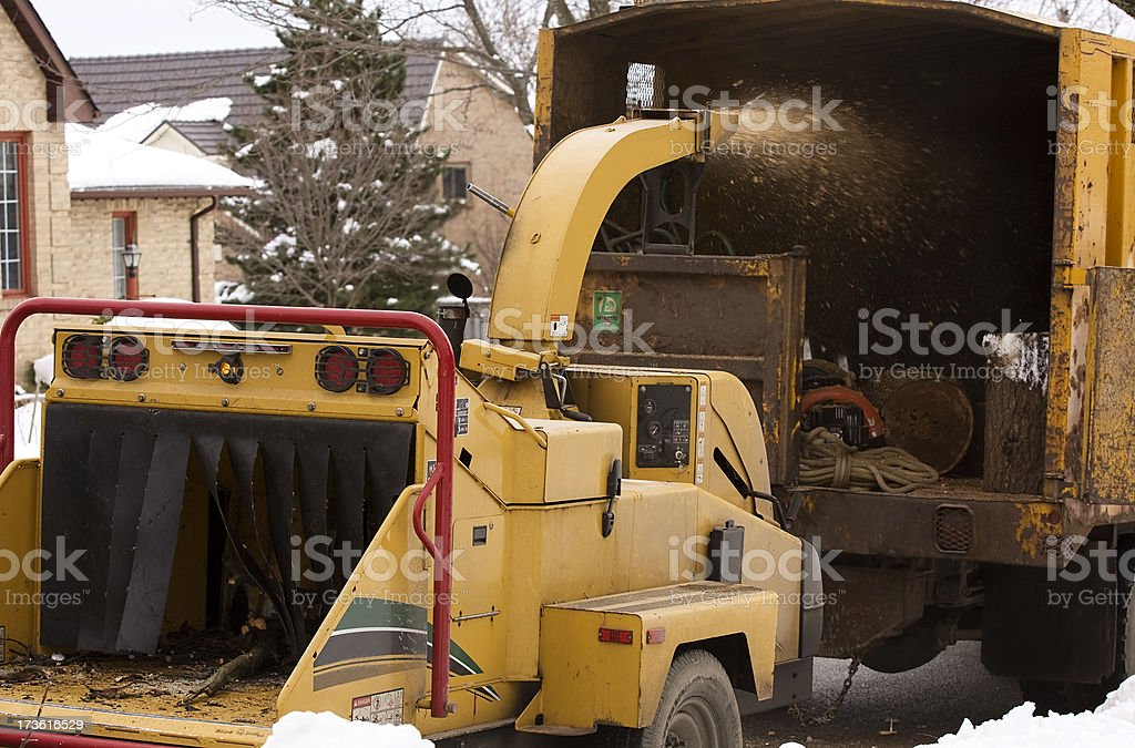 Wood chipper in action stock photo