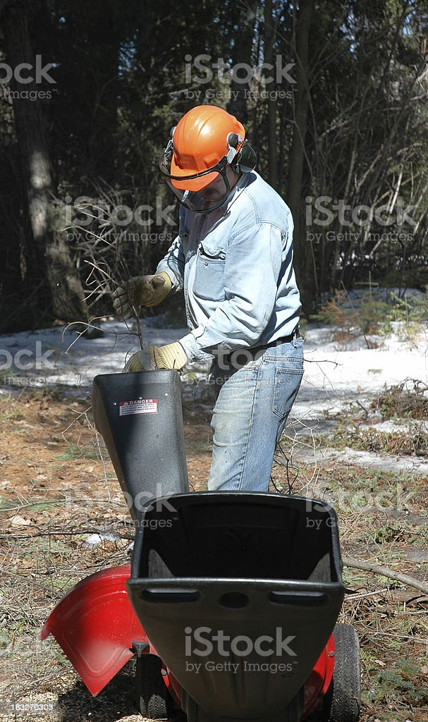 Wood chipper man stock photo
