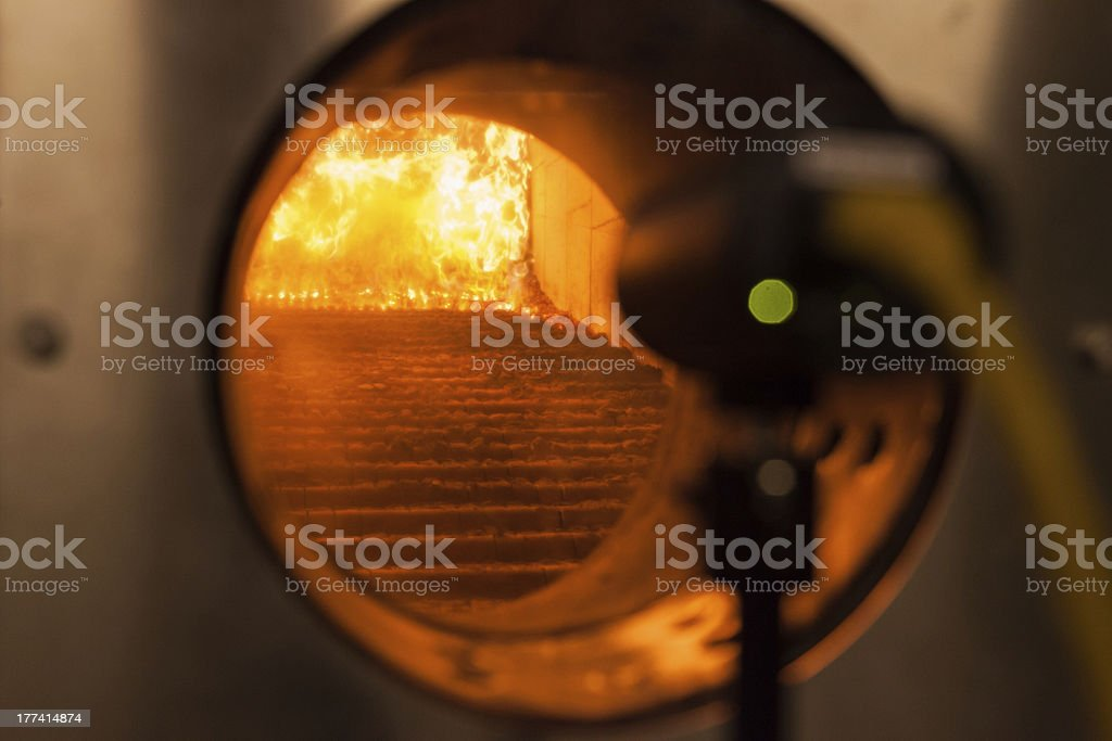 Wood chips in a furnace royalty-free stock photo