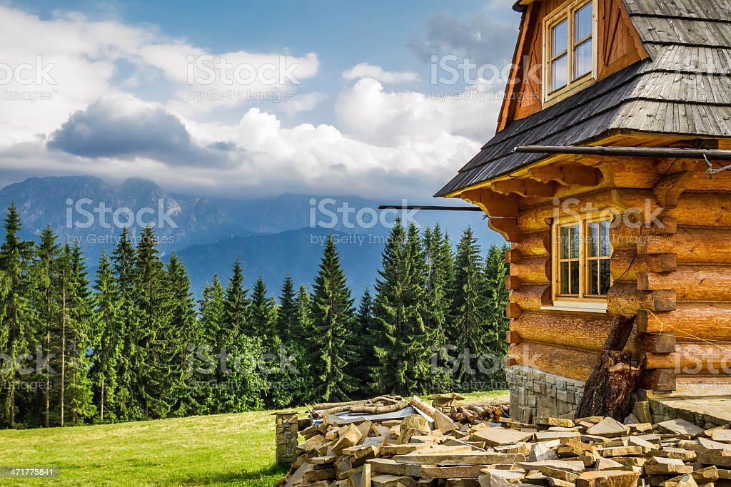 Wood cottage with a beautiful forest and mountain views stock photo