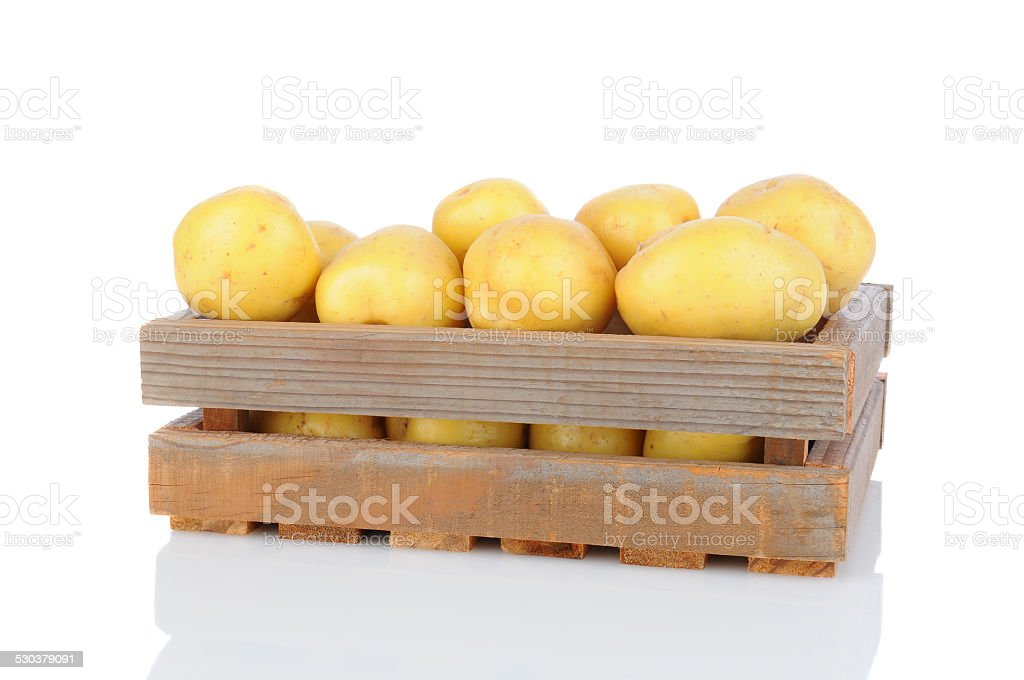 Wood Crate Full of White Potatoes stock photo
