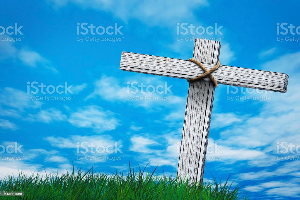 conceptual wood cross or religion symbol shape over a sunset sky with...