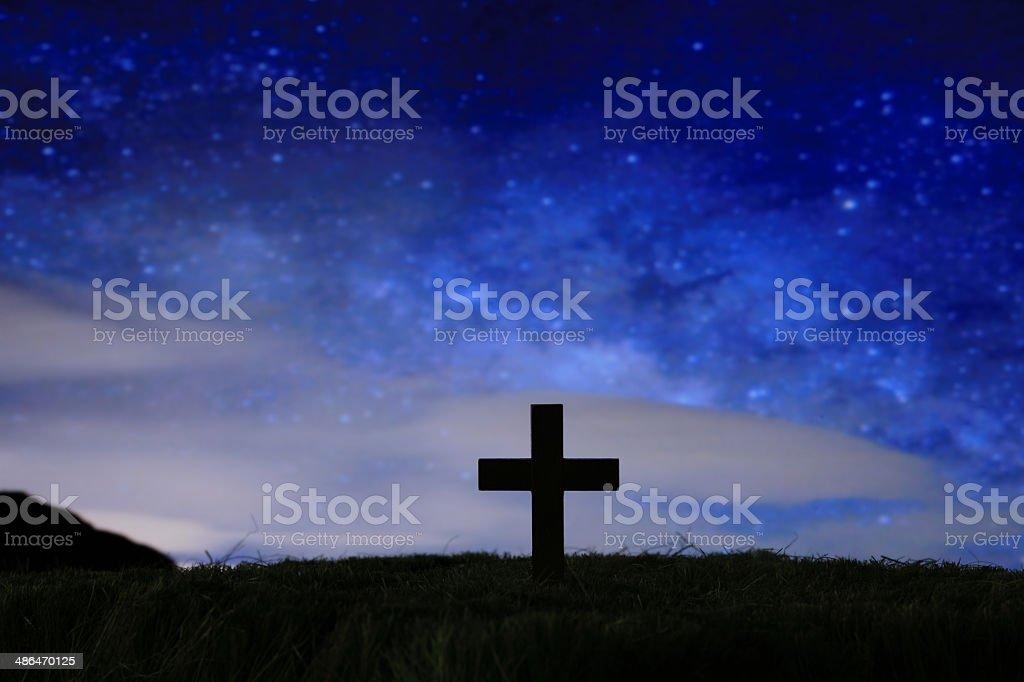 wood cross over a dark night starry sky stock photo