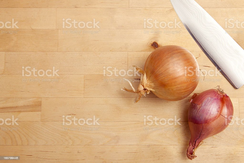 Wood Cutting Board with Chef's Knife, Onion and Shallot royalty-free stock photo