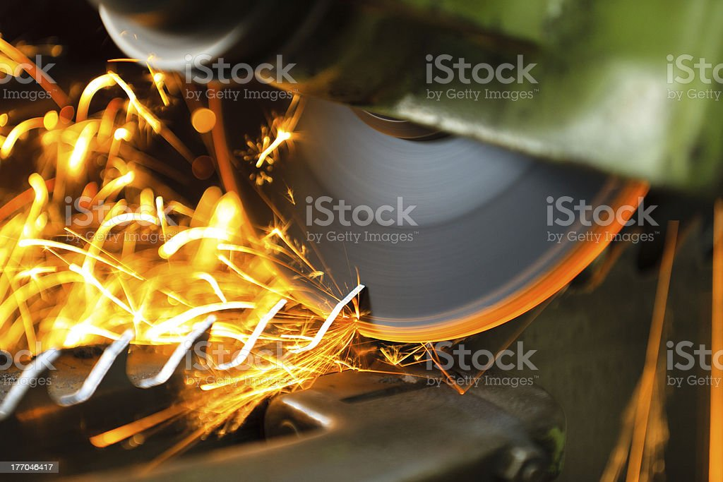 Wood cutting machine during the blade sharpening and sparks stock photo