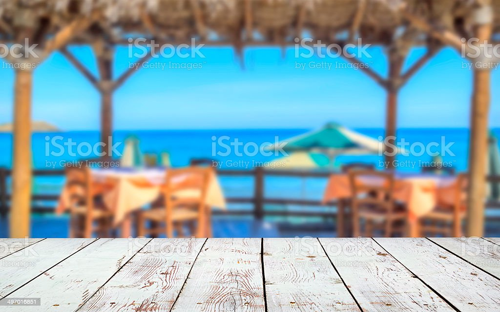 Wood deck in front of beach with sea view. stock photo