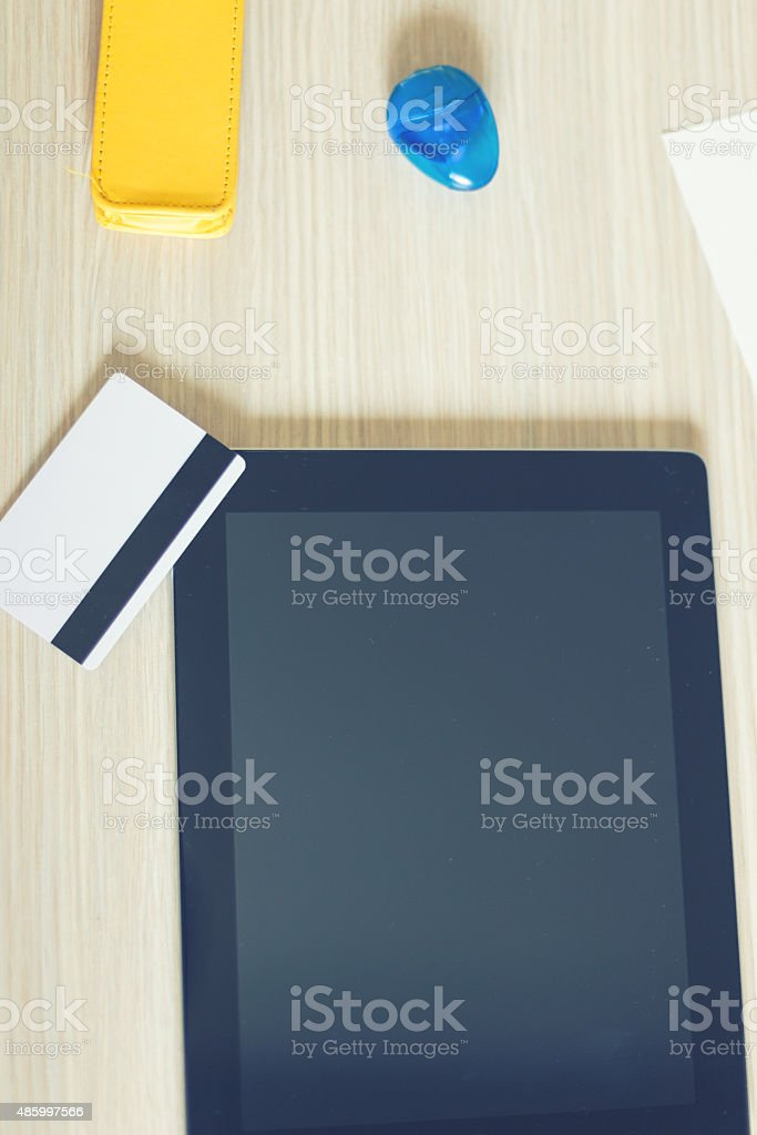 Wood desk and office supplies stock photo