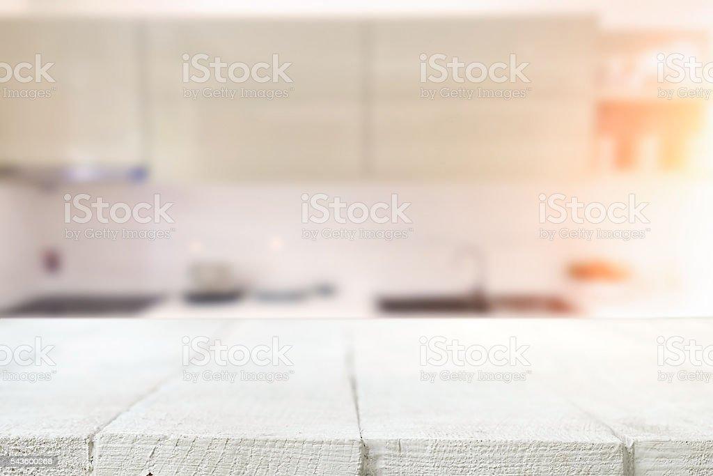 Wood desk space and blurred of kitchen background. stock photo