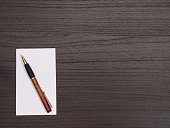 Wood Desktop, White Notepad, Pen