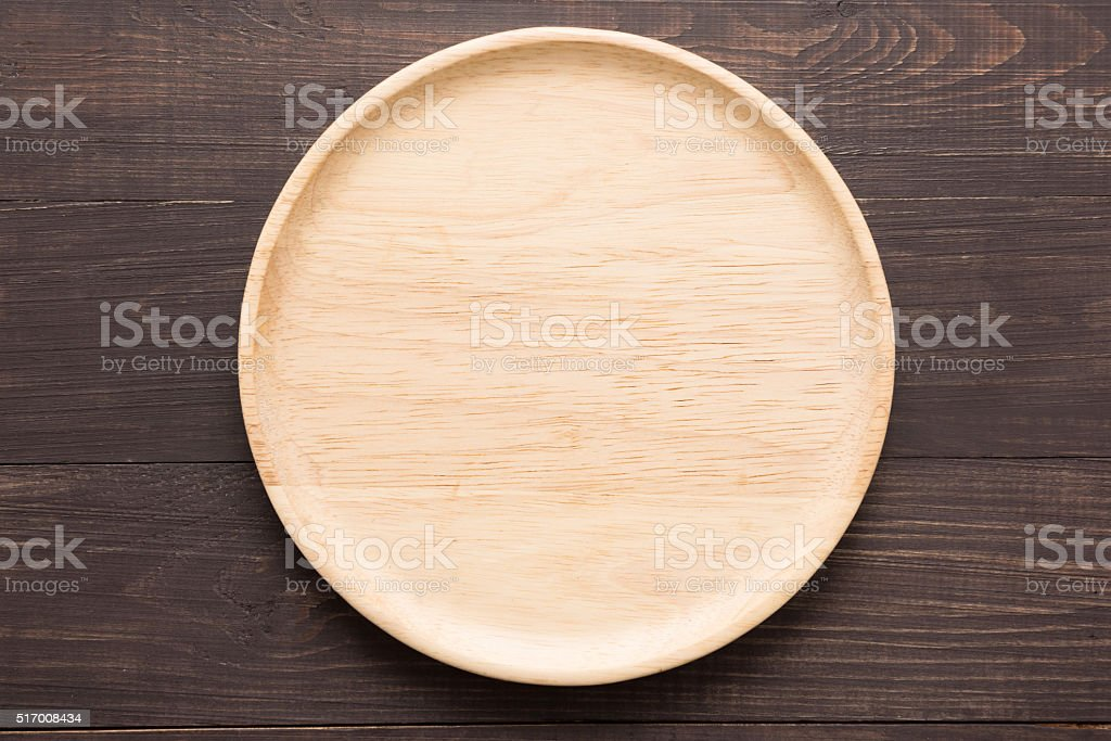Wood dish on the wooden background. Top view stock photo
