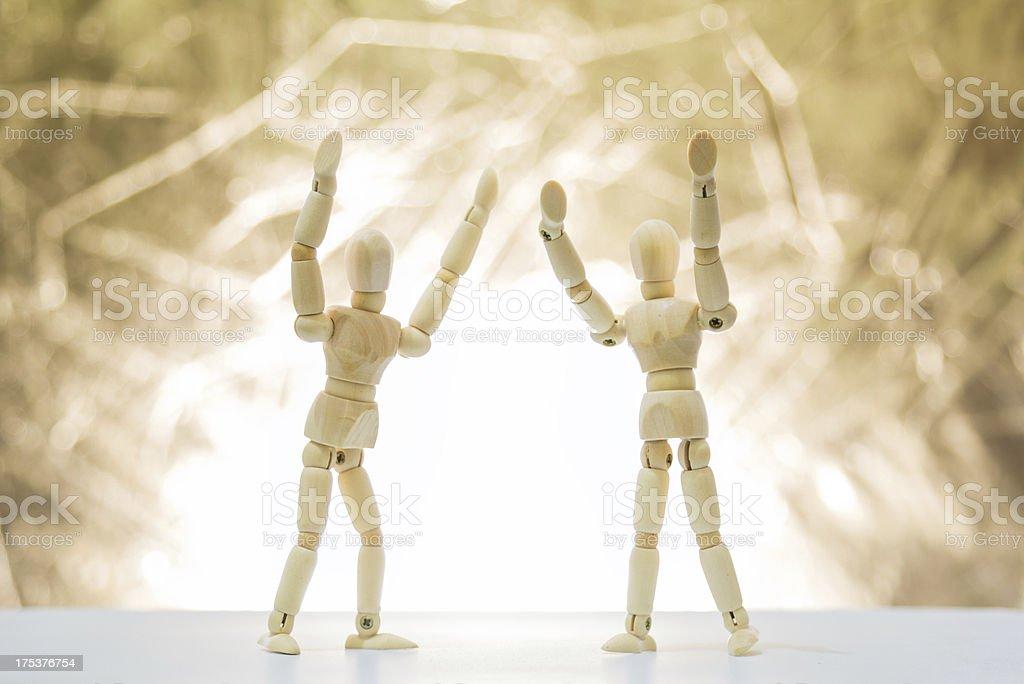 Wood doll cheering royalty-free stock photo