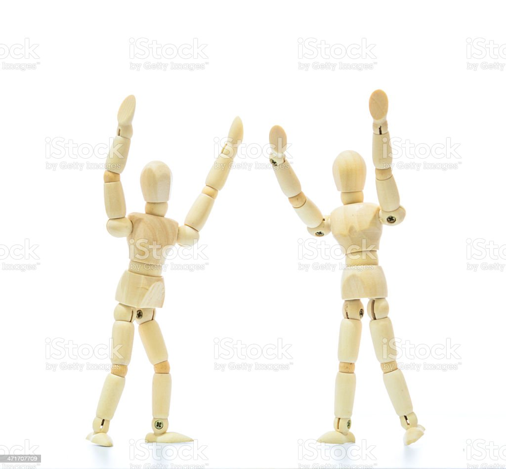 Wood doll cheering royalty-free stock photo