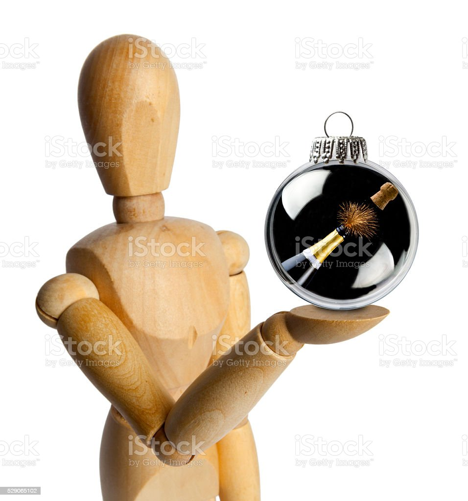 Wood Doll with a Bottle of Champagne in a Christmas Ornament stock photo