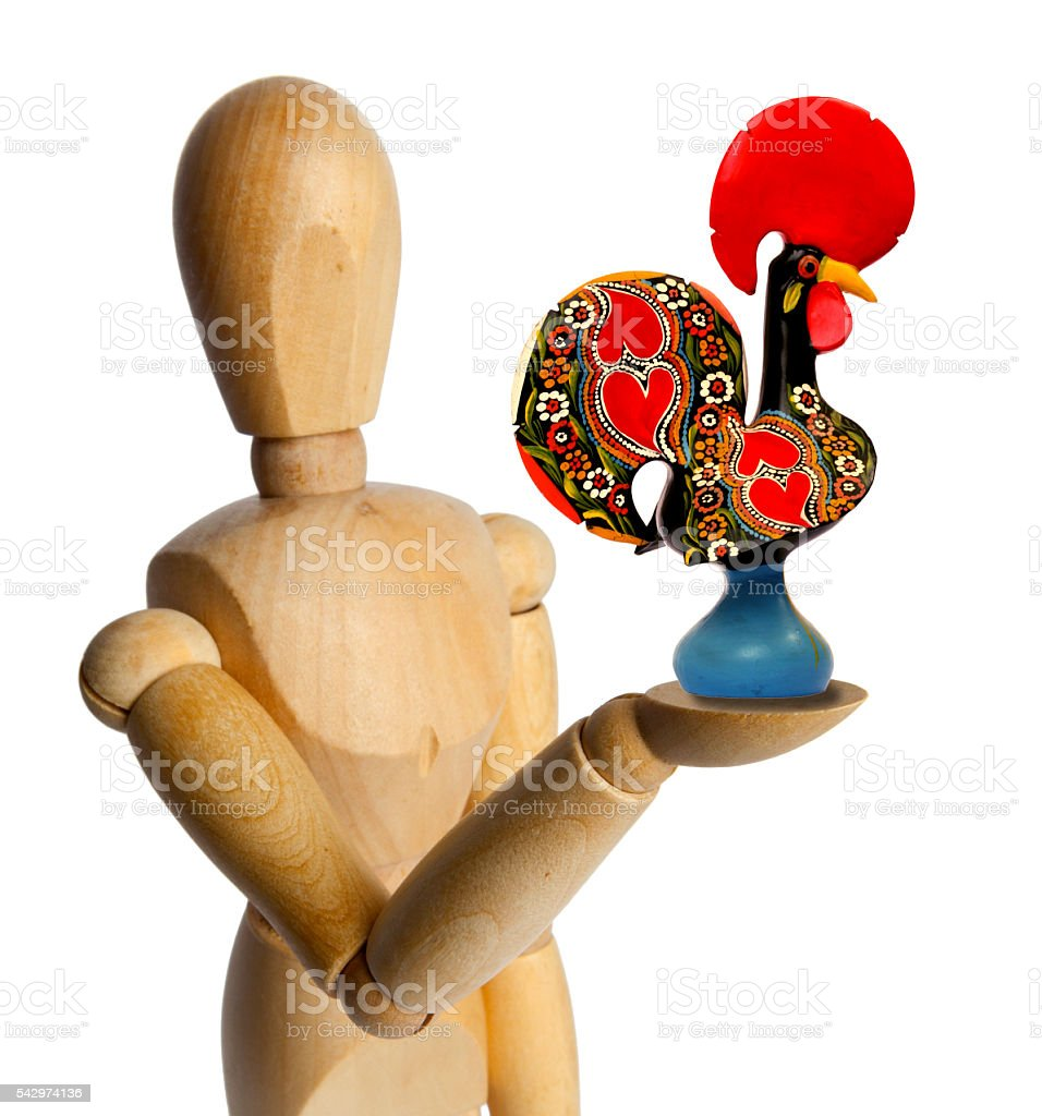Wood Doll with a Galo de Barcelos stock photo