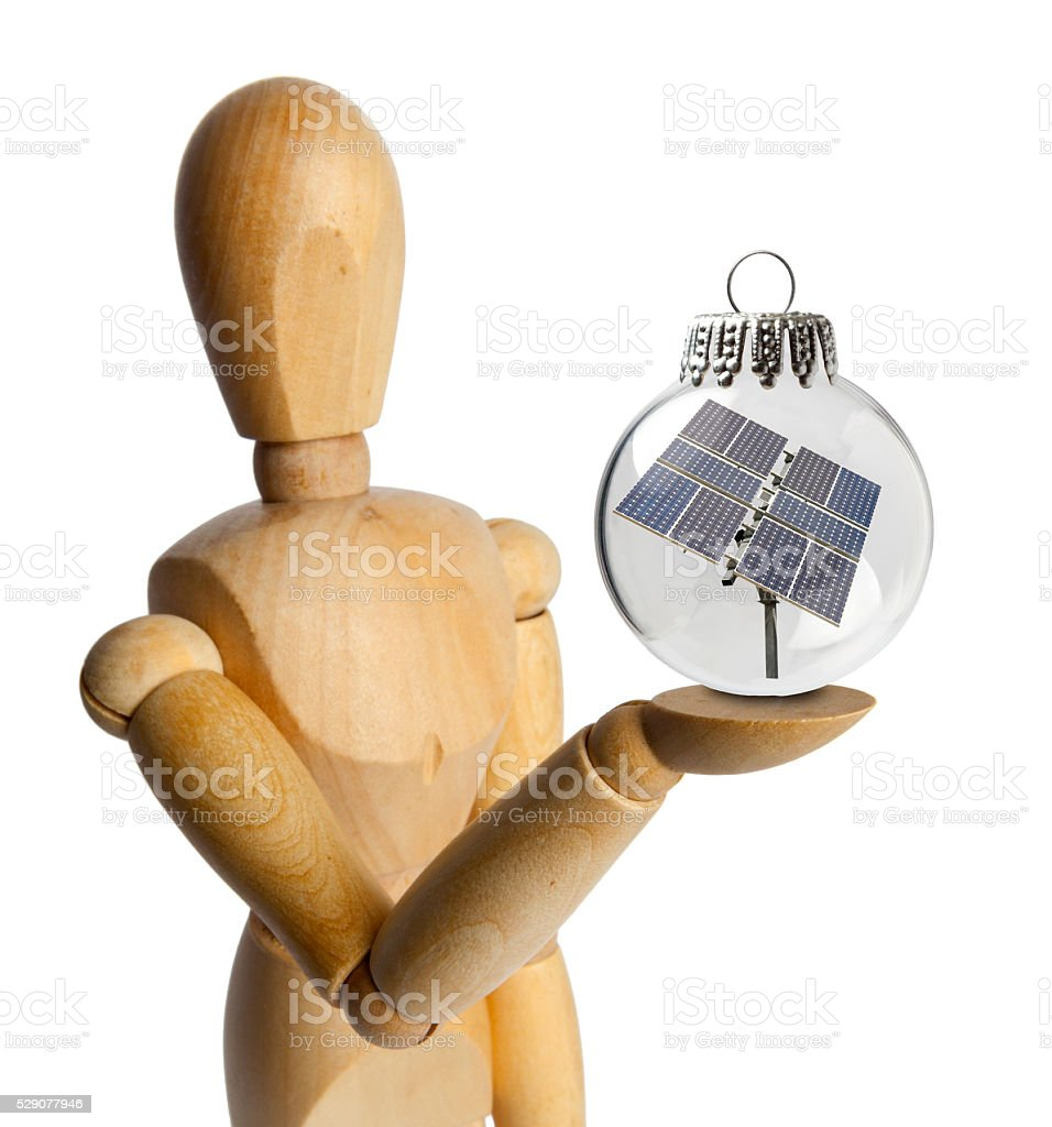 Wood Doll with a Solar Panel in a Christmas Ornament stock photo