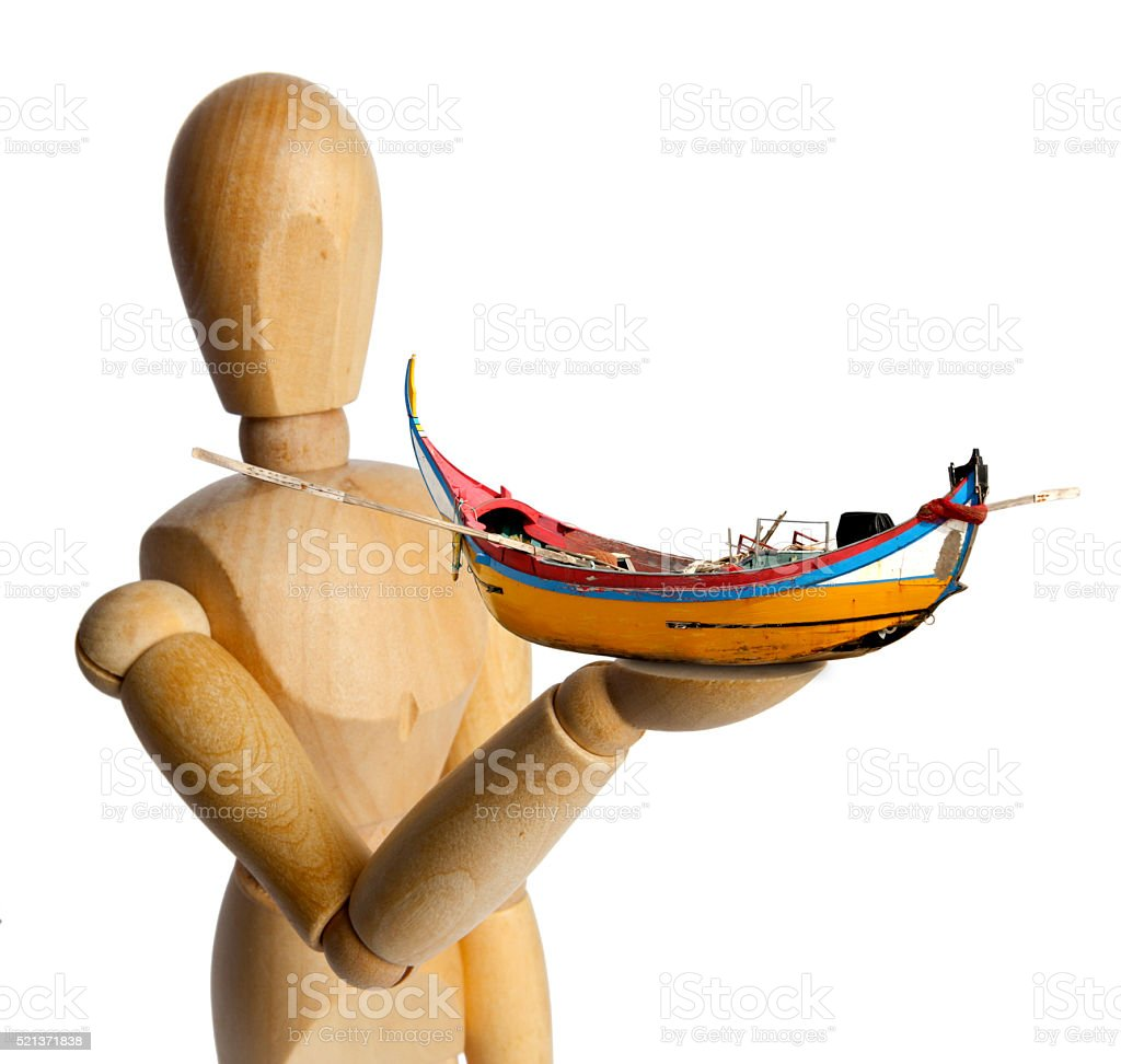 Wood Doll with a Traditional Fishing Boat stock photo