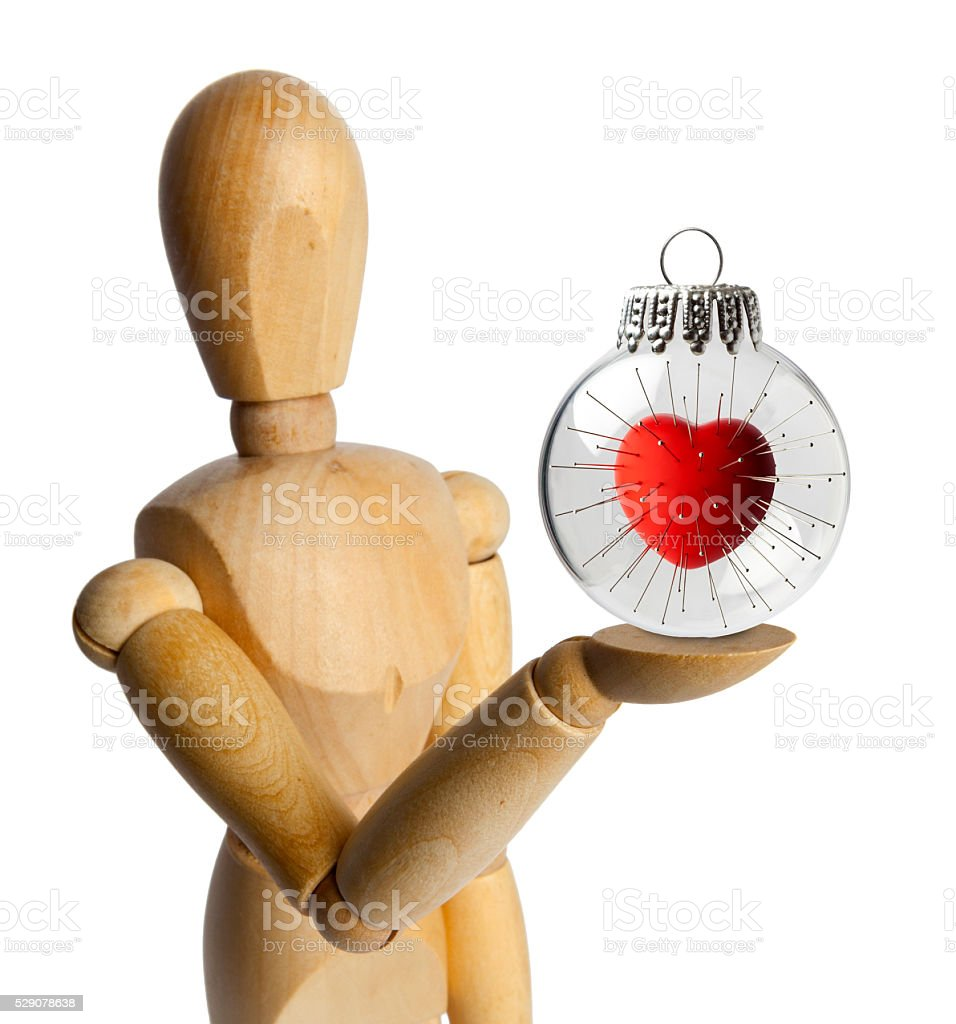 Wood Doll with a Vodoo Heart in a Christmas Ornament stock photo