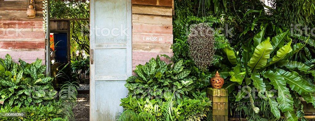 wood door in the garden stock photo
