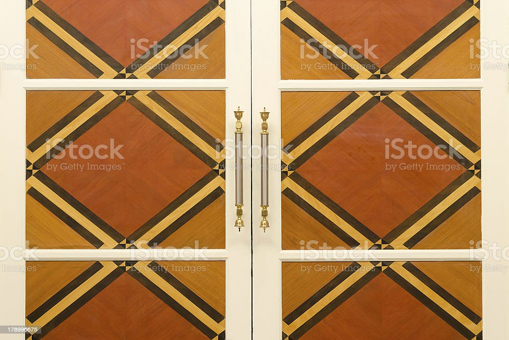 Wood door with stainless handles royalty-free stock photo