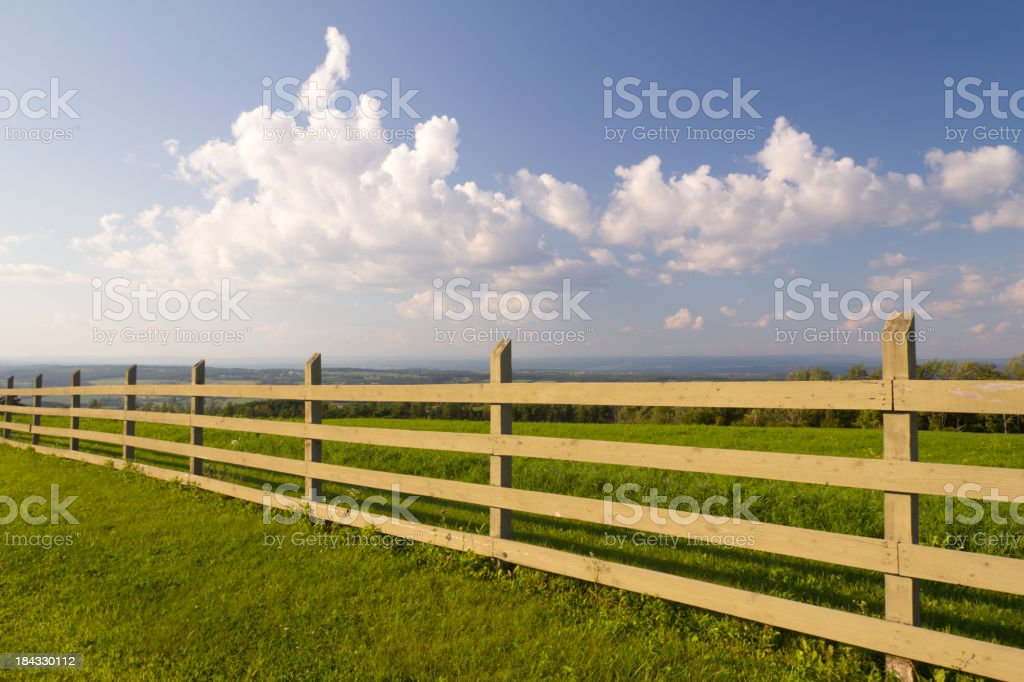 Wood Fence & Afternoon Sky stock photo
