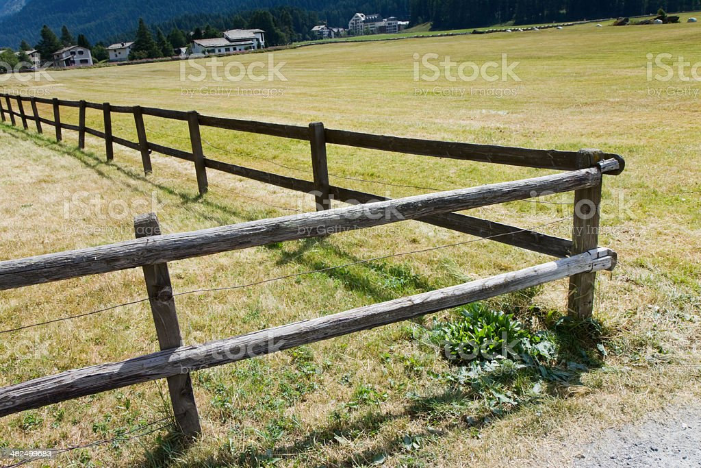 Wood fence in Engadine Valley royalty-free stock photo