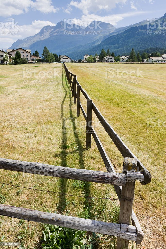 Wood fence in Engadine Valley stock photo